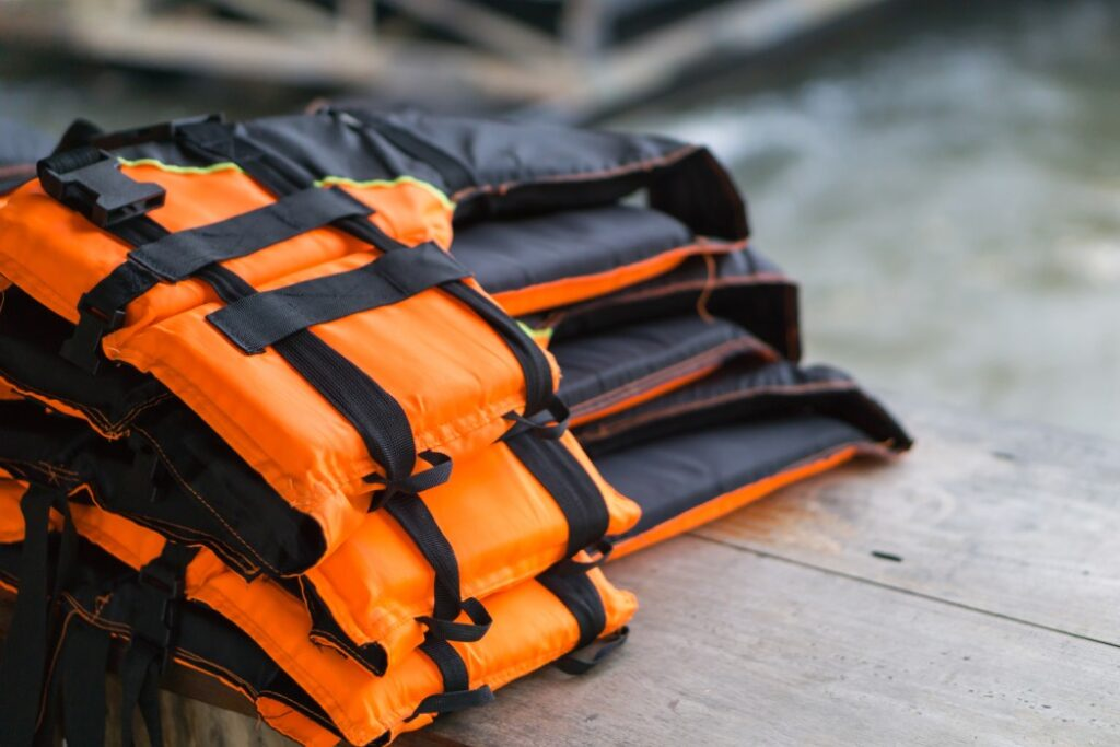 Life jackets laying on lake deck how to properly store personal flotation devices