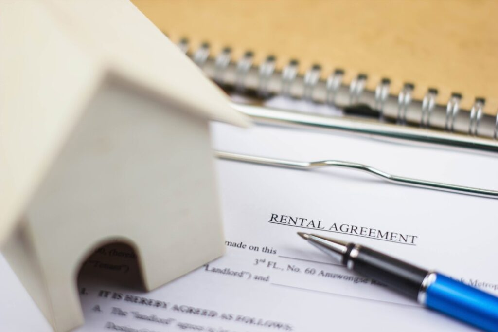 rental agreement paper with pen and house