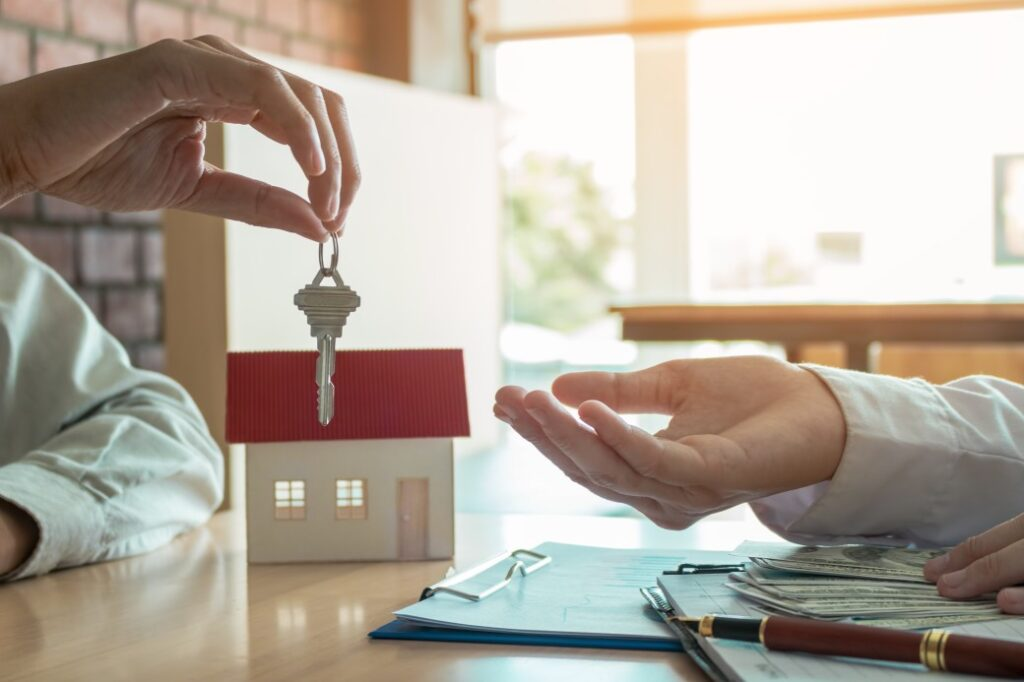 person handing keys over for rental agreement