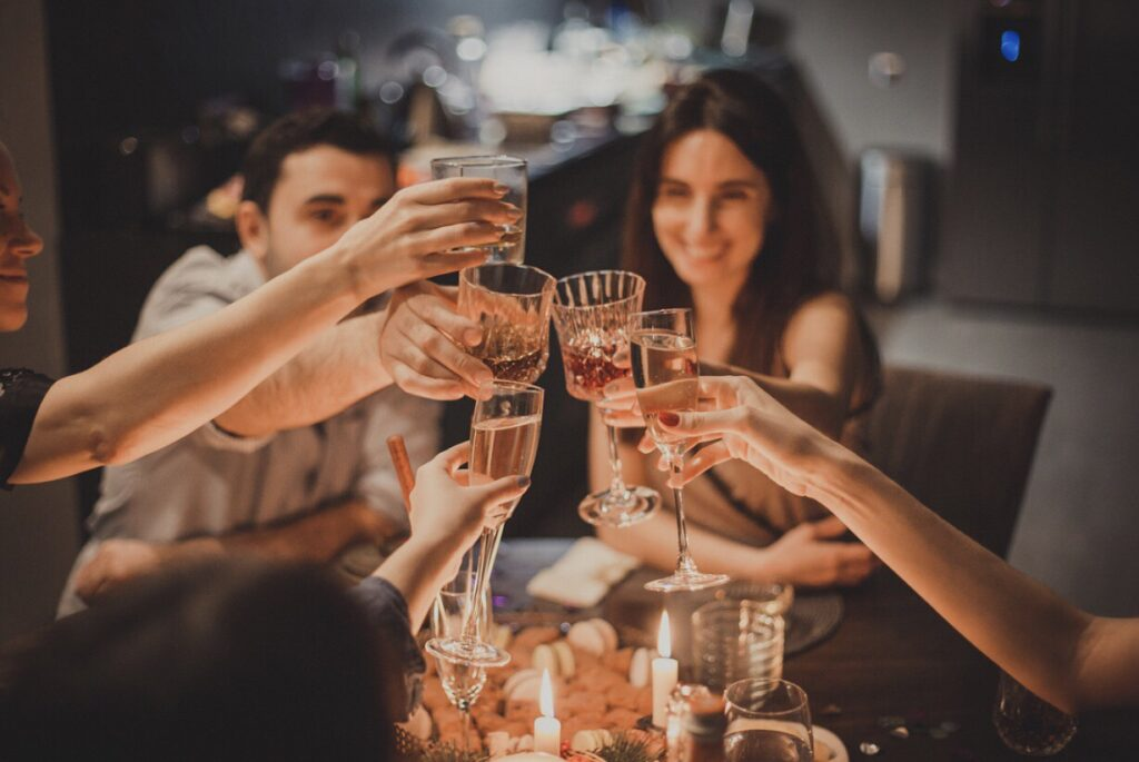 Friends and family toasting at dinner party