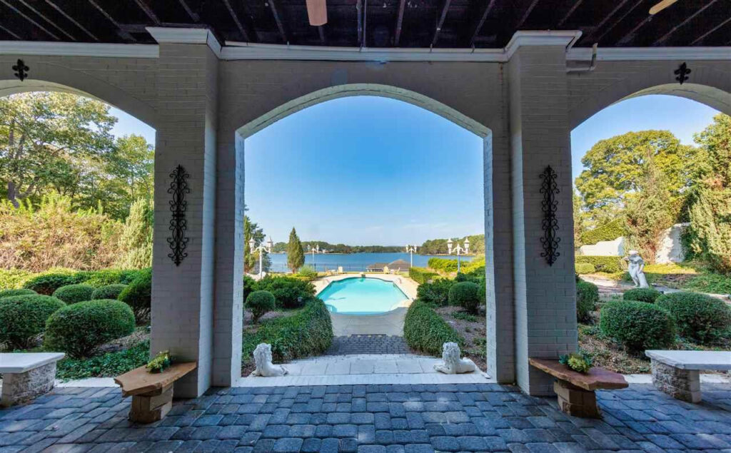 Veranda and pool view in lake house on Lay Lake French Chateau