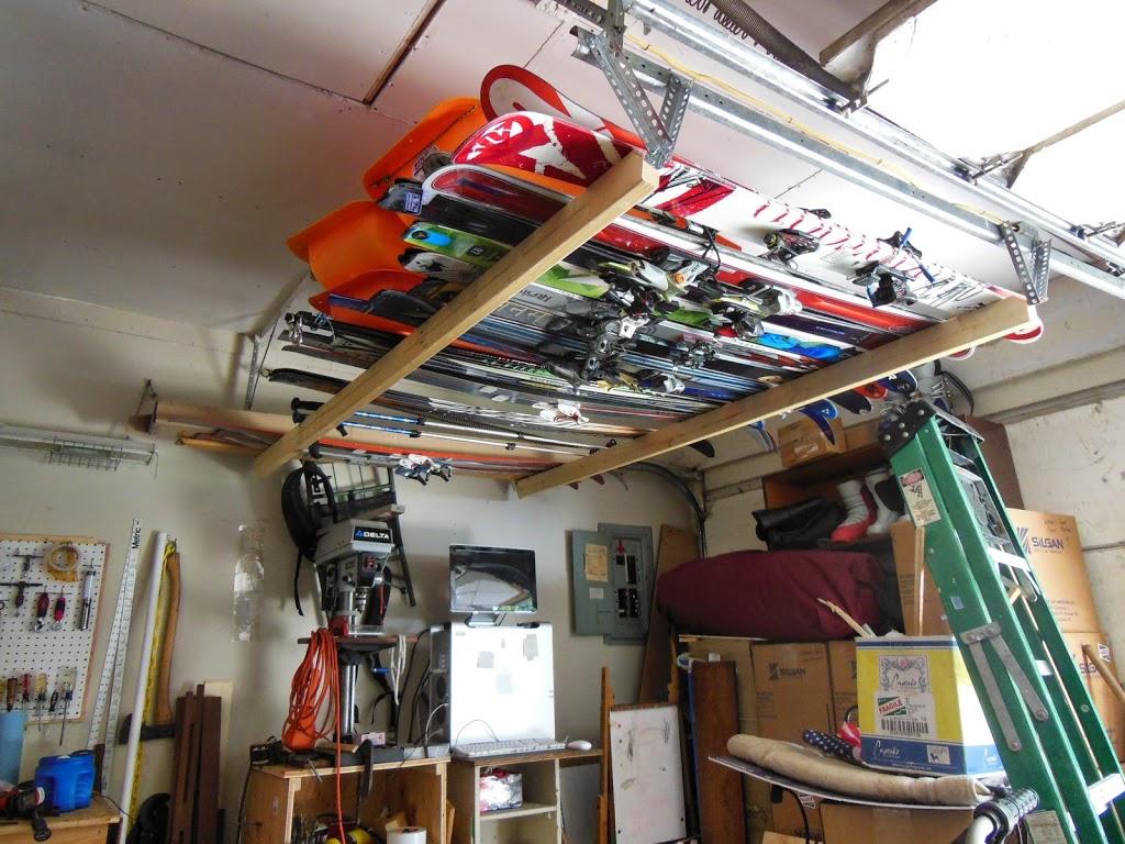 Lake gear organization garage ceiling water skis