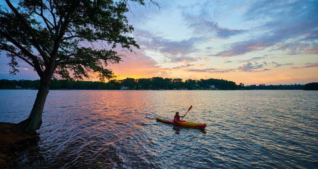 person kaying on lake murray, south carolina