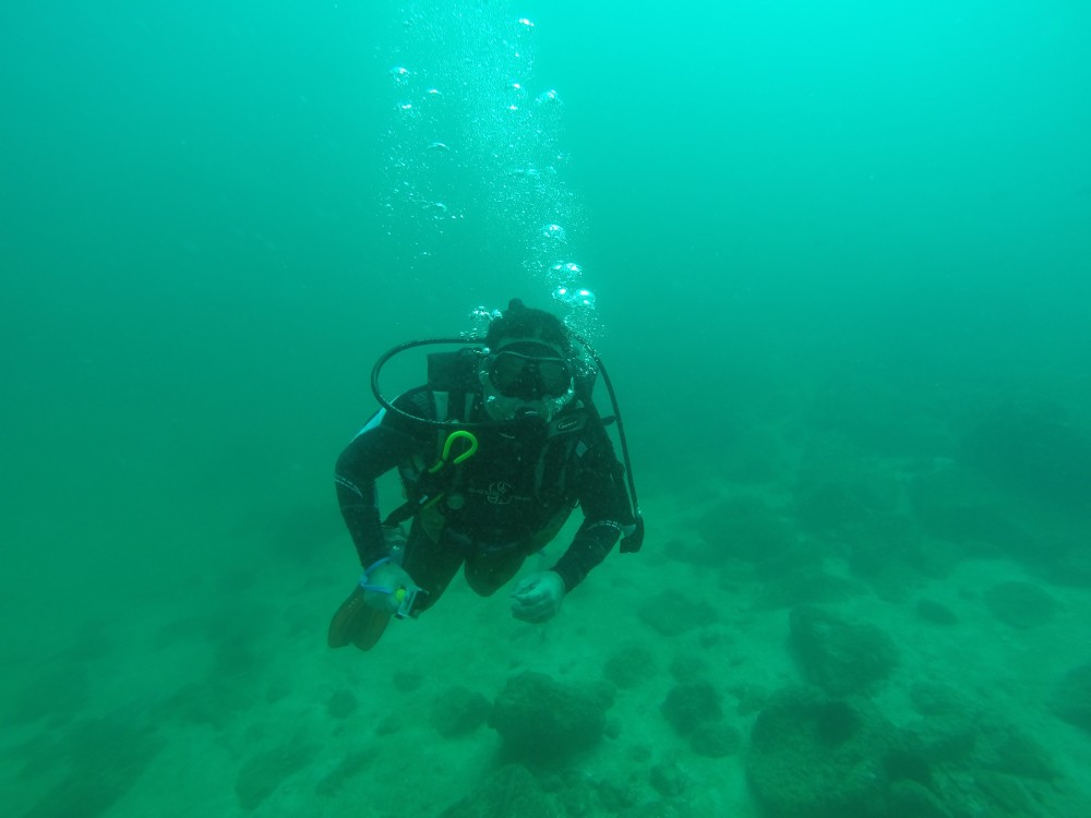 person scuba diving at lake keowee