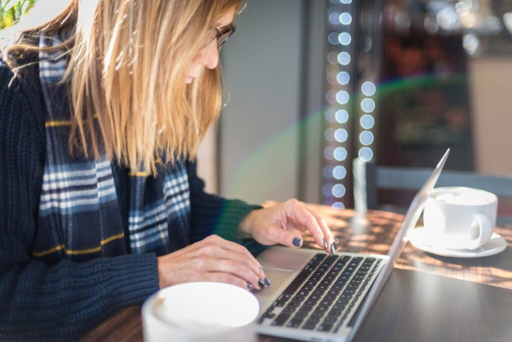 Woman using laptop to look up real estate