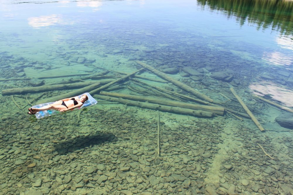 Woman floating on clear Flathead lake