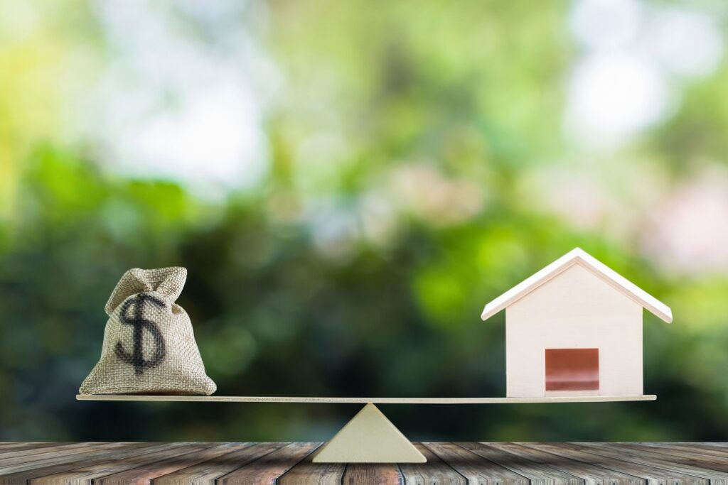 balancing act between house and mortgage Vacation Home Issues