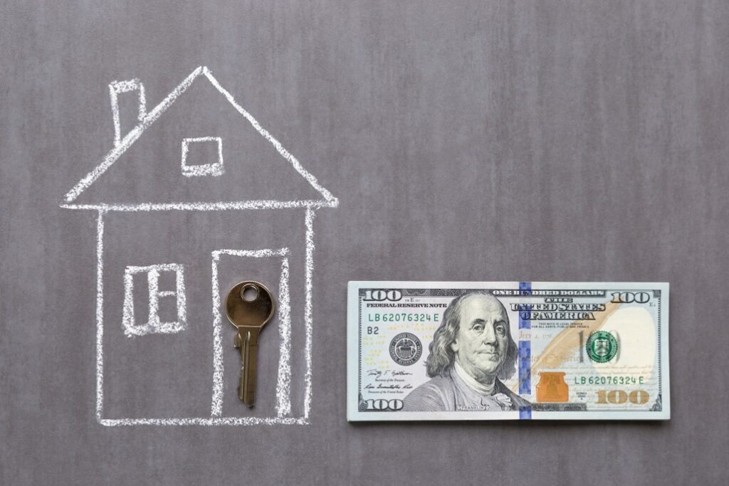 chalk drawing of for-sale-by-owner-house with key in doorway next to $100 bill